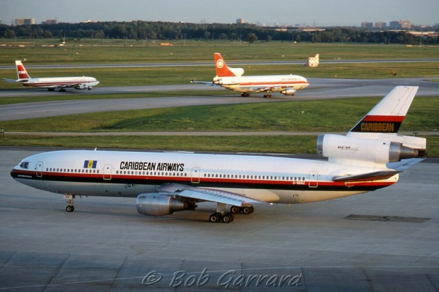 A Caribbean Airways DC-10 with a Lockheed L1011 and Boeing 707 in the background - Photo: Bob Garrard