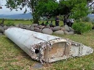 This image taken from video, shows a piece of debris from a plane, Wednesday, July 29, 2015, in Saint-Andre, Reunion. Air safety investigators, one of them a Boeing investigator, have identified the component as a flaperon from the trailing edge of a Boeing 777 wing, a U.S. official said. Flight 370, which disappeared March 8, 2014, with 239 people on board, is the only 777 known to be missing. (Reunion 1ere via AP) FRANCE OUT