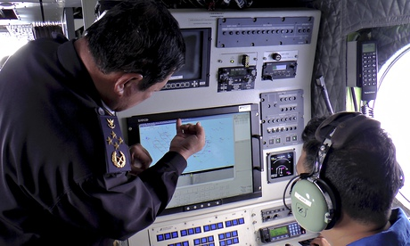 The head of the MMEA, Mohd Amdan Kurish, left, checks a radar during search for the missing plane