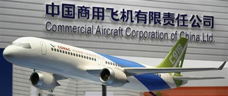 UK-AIRSHOW-SINGAPORE-COMAC:China s COMAC learns plane building isn t easy