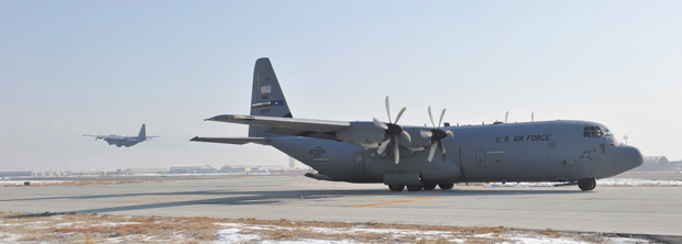 A U.S. Air Force C-130H model aircraft takes off on its last flight out of Bagram Airfield, Afghanistan while a newer C-130J model aircraft taxis in to replace it. Researchers at the Air Force Academy are testing aircraft including older C-130s to help identify potential age-related problems before they arise.
