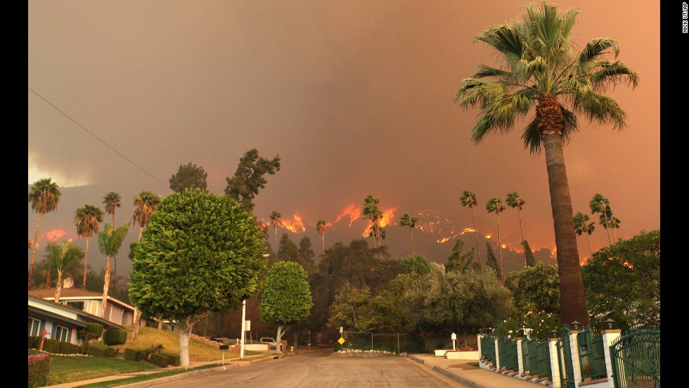The report breaks the country down by region and identifies specific threats should climate change continue. Major concerns cited by scientists involved in creating the report include rising sea levels along Americas coasts, drought in the Southwest and prolonged fire seasons. In this image from January 16, a wildfire burns in the hills just north of the San Gabriel Valley community of Glendora, California.