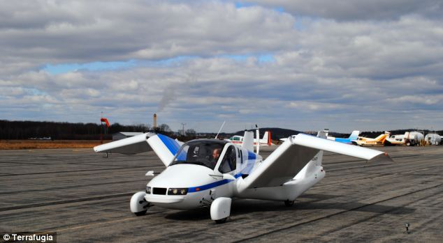 This shot shows the Transition plane switching from drive mode to fly mode. The wings fold into the side of the car, built from a Sedan design. Drivers can only take off in the Transition from a runway. The Transition has a maximum flight speed of 115mph