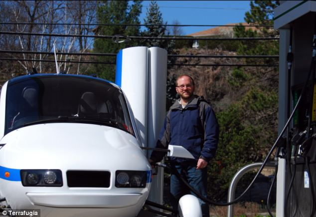 A Terrafugia test pilot fills up the Transition flying car with petrol. The Transition can hold 23 gallons of usable fuel and uses 5 gallons per hour during flight. On the ground, it gets 35 miles per gallon