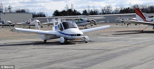 The Transition, pictured, can reach speeds of around 70 miles per hour on the road and 115 in the air. It flies using a 23-gallon tank of automotive fuel and burns 5 gallons per hour in the air. The flying car is 2m tall, 2.3m wide and 6m long with a wingspan, pictured, of 8m