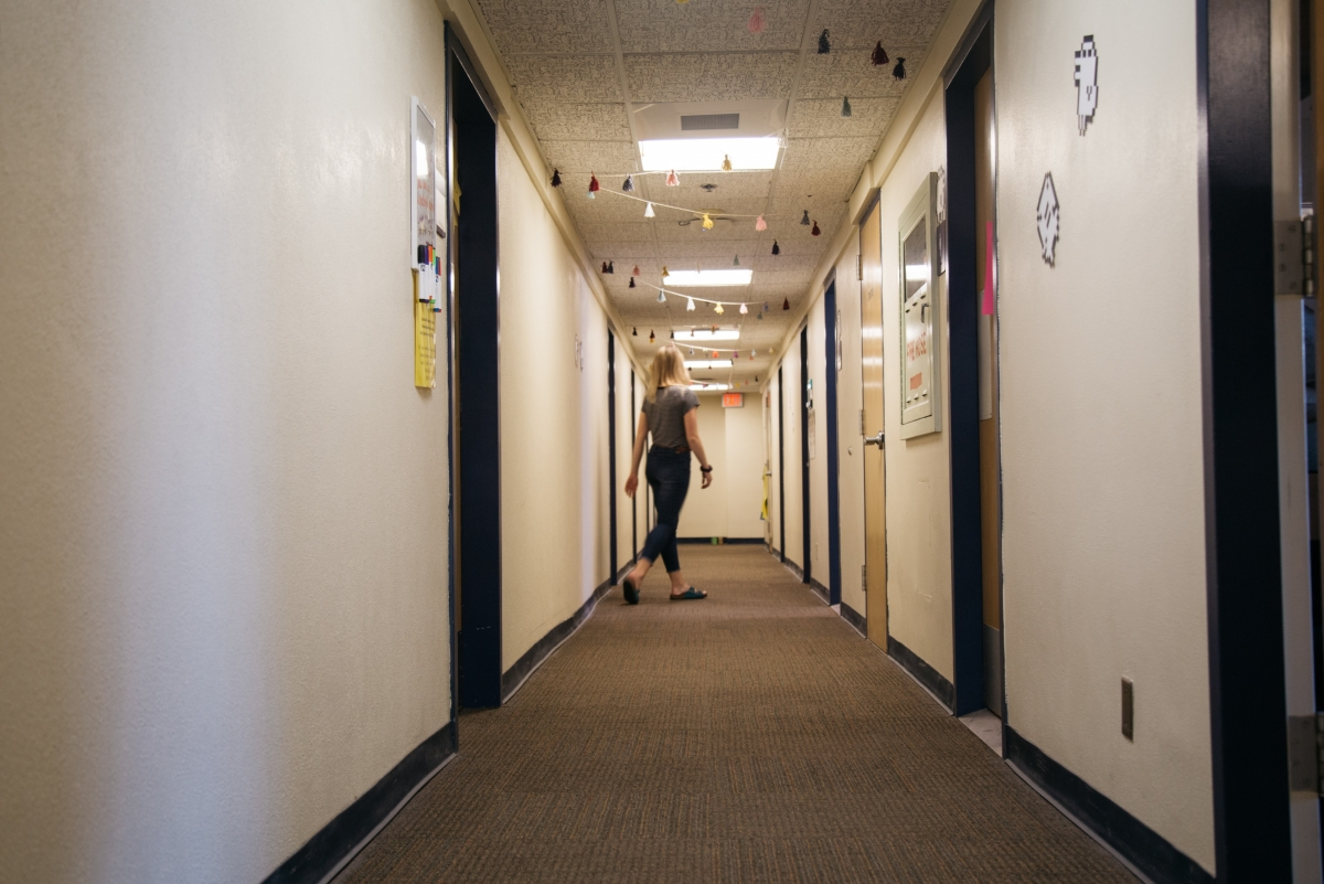 An RA roams the dorm hallways for her hourly night duty rounds in Corrado Hall.nbsp;